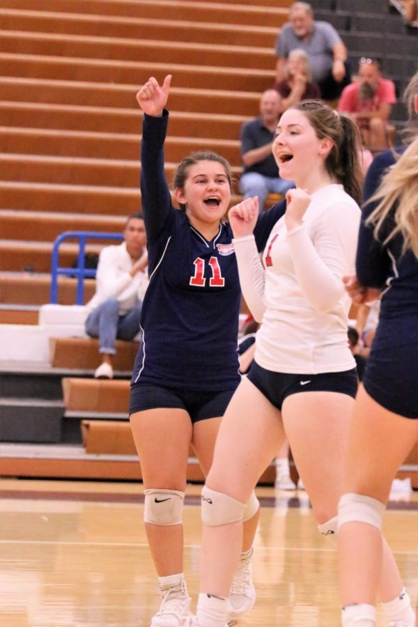 Sophomore Christina Sloan and senior Madison Daniels are celebrating after getting a point.