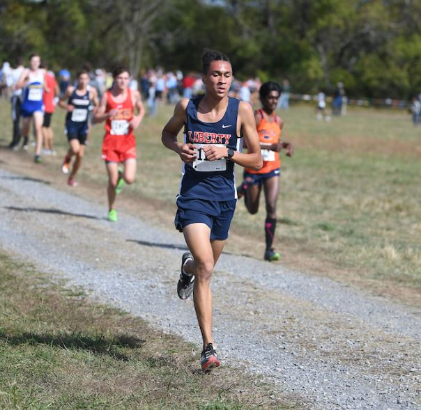 Sam Rodman runs ahead in one of his cross country meets.