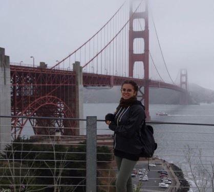 Gaia Giombetti stand in front of the Golden Gate Bridge located in San Francisco, CA.