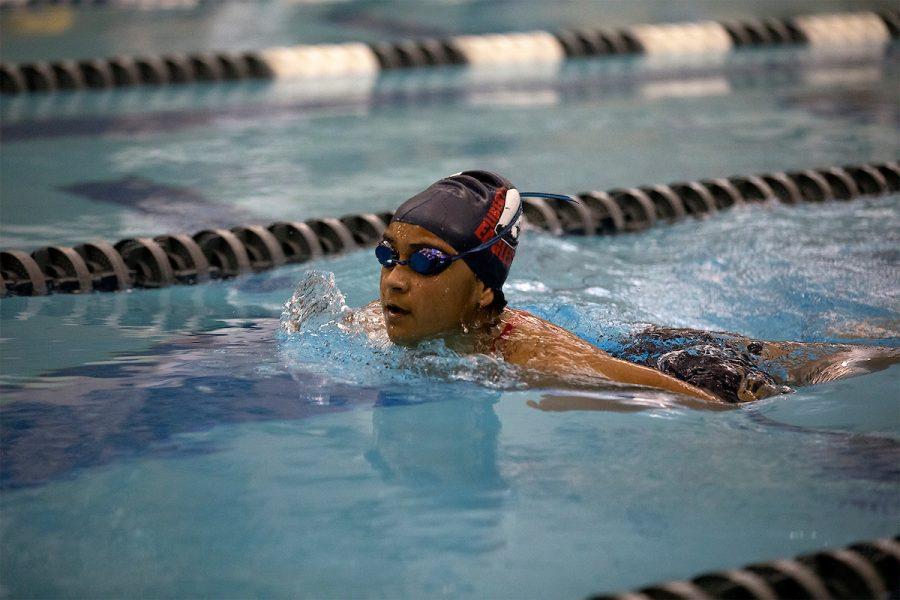 Junior Lana Kraiwan is swimming in her race.