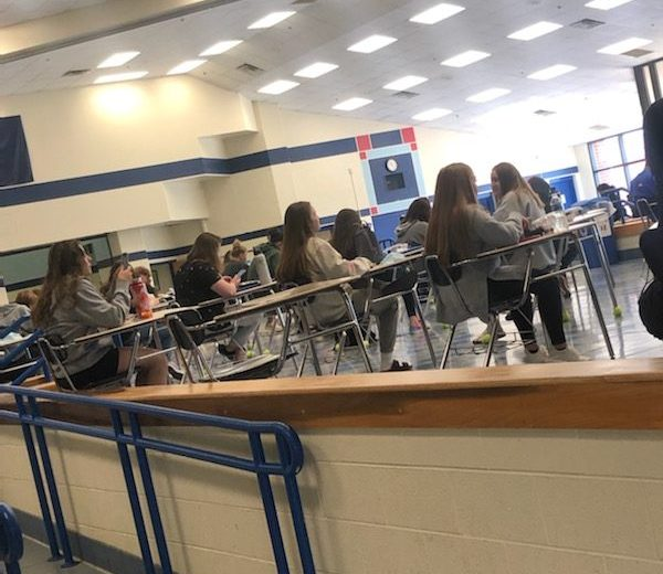 LHS students are enjoying lunch in the cafeteria while maintaining a safe distance.