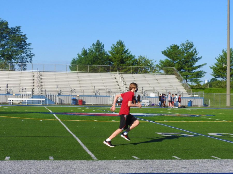 Ethan Day sprints down the sideline for his long jump.